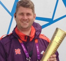 James Wise with the Olympic Torch from London 2012